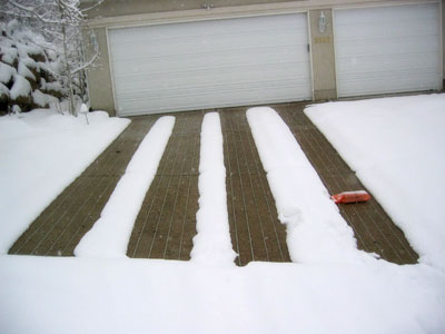 WarmQuest's snow melting cables retrofit into asphalt or concrete for heated driveways without demolition